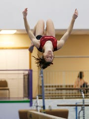 McCutcheon gymnast Megan Walker practices on the balance beam Wednesday, January 18, 2017, at Elite Gymnastics, 3822 Fortune Drive in Lafayette. Walker is a sophomore.