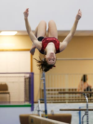 Megan Walker won an individual sectional title Saturday on the beam.