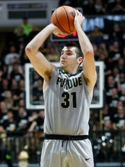 Dakota Mathias drains a 3-point shot against Michigan in a 92-88 victory this past January.