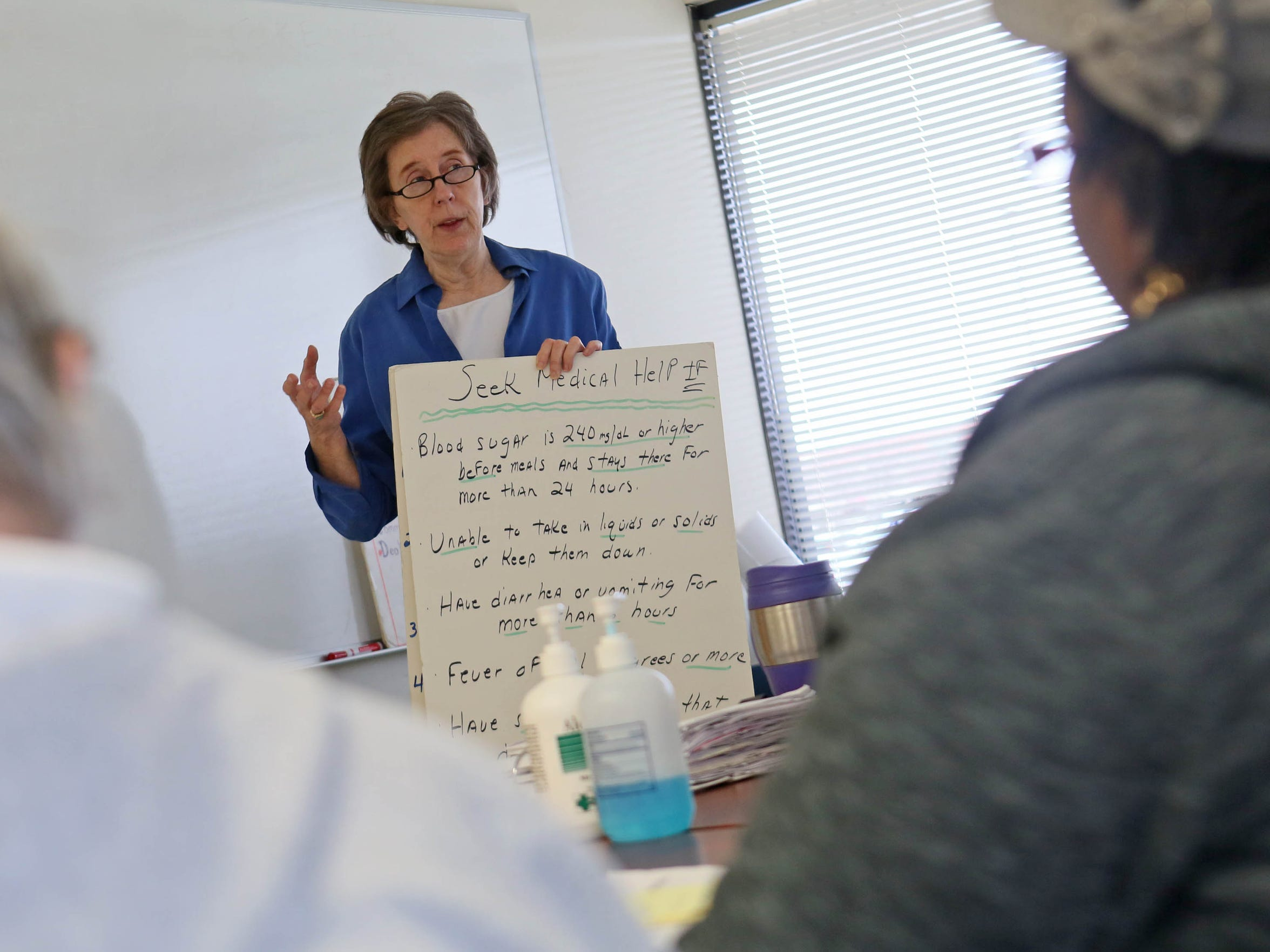 Kathy Stroh, a certified diabetes educator for Westside Family Healthcare, leads a class on diabetes self management. Type 2 diabetes is more common than Type 1 diabetes, an autoimmune condition.