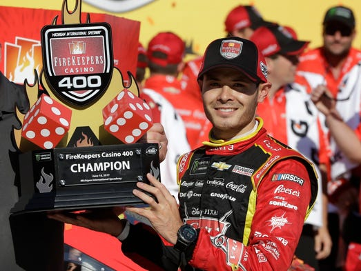 Kyle Larson holds the FireKeepers Casino 400 trophy
