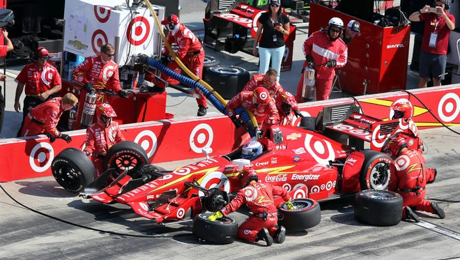 Scott Dixon, of New Zealand, makes a pit stop during the IndyCar Grand Prix at The Glen auto race Sunday, Sept. 4, 2016, in Watkins Glen, N.Y. (AP Photo/Mel Evans)