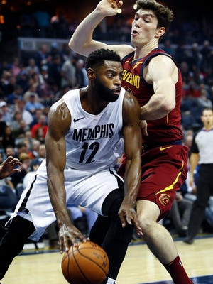 Memphis Grizzlies guard Tyreke Evans (left) drives against Cleveland Cavaliers defender Cedi Osman (right) during first quarter action at the FedExForum in Memphis, Tenn., Friday, February 23, 2018.