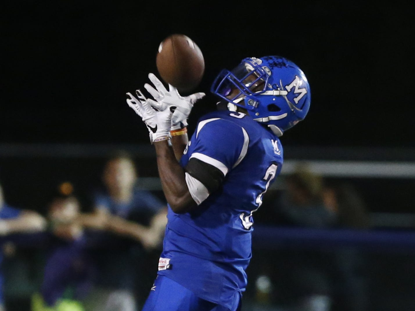 Middletown's Kedrick Whitehead is left alone as he collects a long pass in the first quarter at Cavalier Stadium Friday.