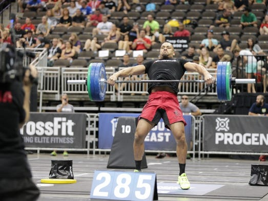 Fort Myers native Jeff Evans completed a 285-pound hang snatch to finish in a tie for first in the opening event of the CrossFit South East Regional in Jacksonville Friday. Evans finished second in the 46-man region, earning one of three berths to the CrossFit Games.