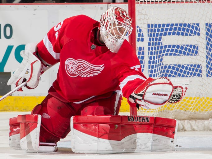 Red Wings  goalie Jimmy Howard makes a save against