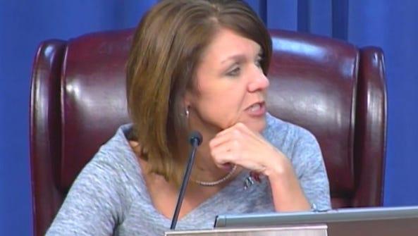 School Board member Alva Striplin makes inquiries about