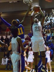 Pineville's Krystal Freeman (25, right) goes for two against East Ascension's F. Williams (11, left).