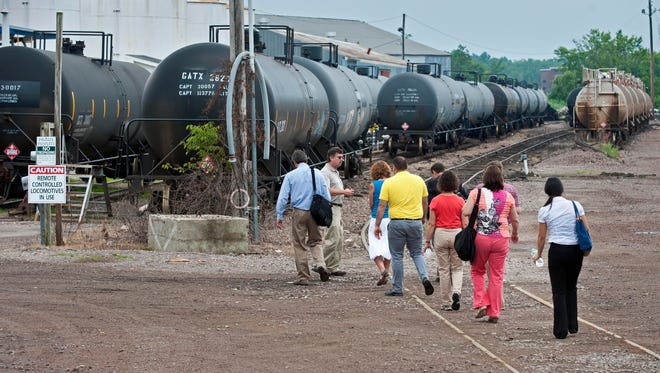 Perry Martel, second from left, leads a tour of the Vermont Rail System rail yard in Burlington on Wednesday.
