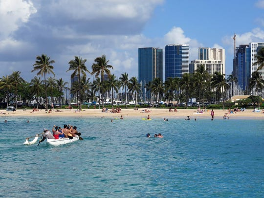 This May 21, 2014, file photo shows Duke Kahanamoku Beach in the Honolulu tourist neighborhood of Waikiki in Hawaii.