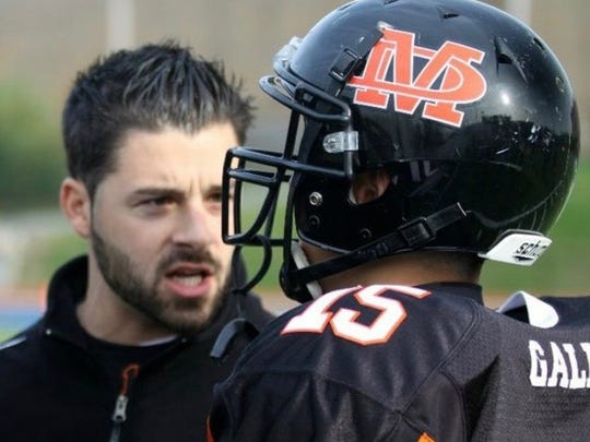 Brian Beck is seen talking to a Marlboro High School football player in this file photo.