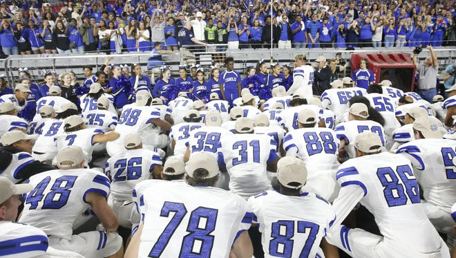 The Chandler football team thanks the fans after defeating Mountain Pointe in the 6A Conference state championship game at University of Phoenix Stadium in Glendale.