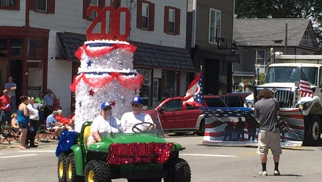 Jeromesville's 200th birthday cake passes by during the community's bicentennial parade on July 25.