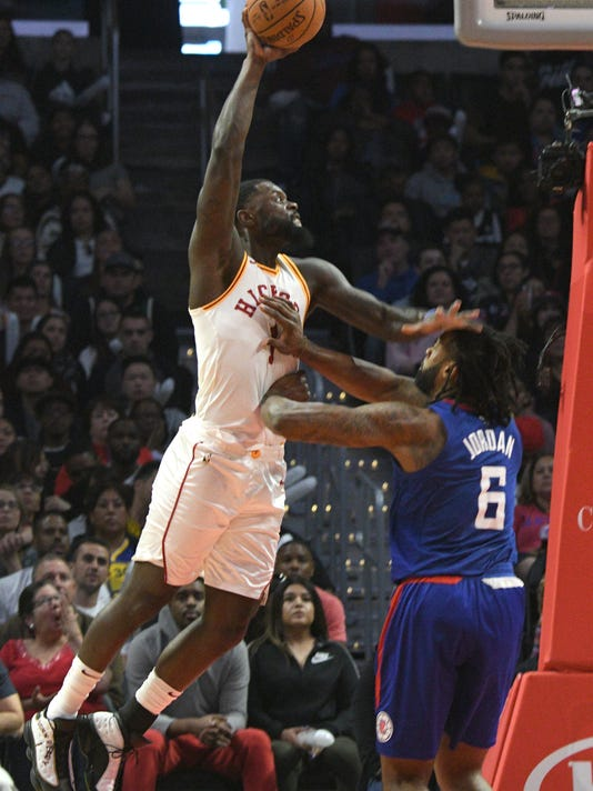 Los Angeles Clippers center DeAndre Jordan (6) defends Indiana Pacers guard Lance Stephenson (1) during the second half of an NBA basketball game Sunday, April 1, 2018, in Los Angeles. Jordan was called for a flagrant foul. The Pacers won 111-104. (AP Photo/Michael Owen Baker)