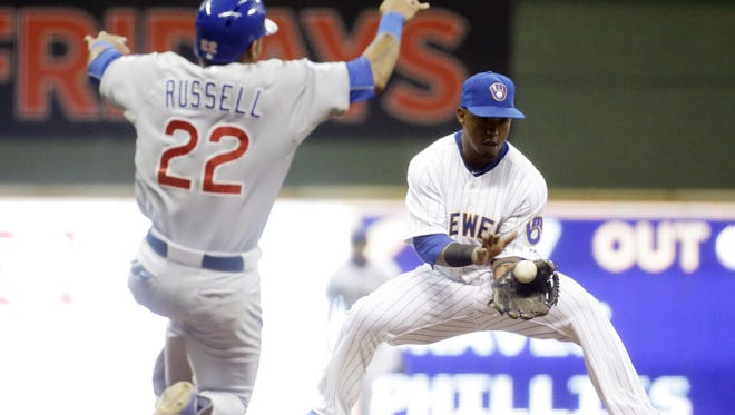 Chicago Cubs' Addison Russell is out at second as Milwaukee Brewers' Jean Segura takes the throw during the fifth inning of a baseball game Friday in Milwaukee.