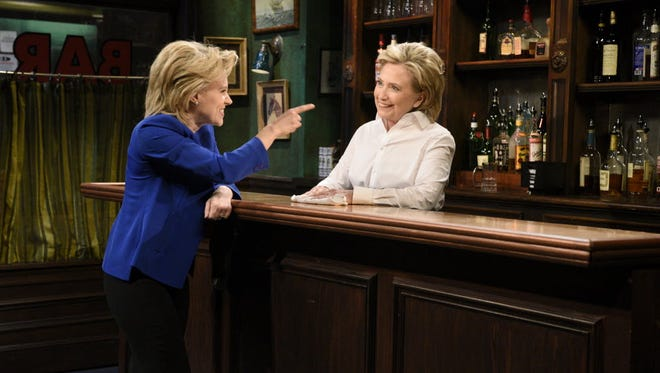 """Kate McKinnon portrays Democratic presidential candidate Hillary Clinton, left, and Clinton on """"Saturday Night Live"""" in New York on Oct. 3, 2015."""