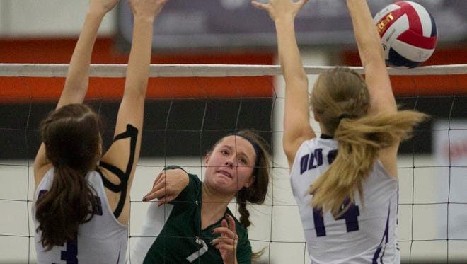 D.C. Everest's Jenna Rombalski, center, hits against Eau Claire Memorial's Emma Hesse, left, and Kayla Sluis, right, during a Division 1 volleyball sectional semifinal last week in Marshfield.
