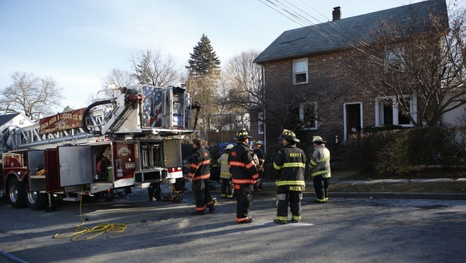 Firefighters on the scene of a fatal fire at 121 St. Marks Place in Mount Kisco, Jan. 20, 2016. A man was trapped in the basement and died. A woman was injured.