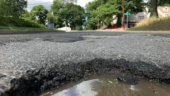 The Clifton City Council has approved a contract for the paving of Dwas Line Road, a mile-long street that has not been resurfaced in 15 years and is riddled with potholes.