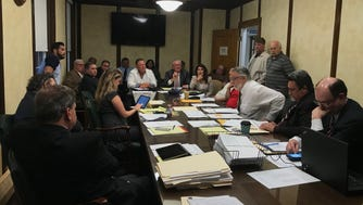 Members of the Garfield council and board of education discussed budget cuts on May 15.