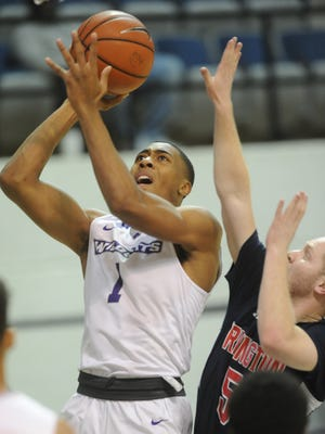 ACU's Jaren Lewis, left, drives to the basket while Arlington Baptist's Eric Wood defends. ACU beat the Patriots 109-60 in the nonconference game Tuesday, Dec. 19, 2017 at Moody Coliseum.