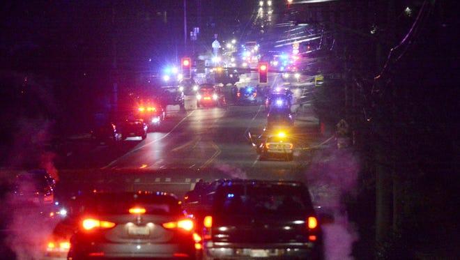 Law enforcement vehicles gather near Skagit Valley College in Mount Vernon, Wash., Thursday, Dec. 15, 2015.