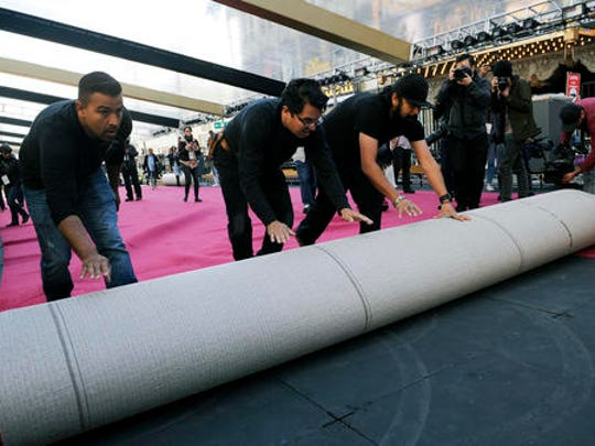 Crew workers roll out the red carpet for the 89th Academy Awards in front of the Dolby Theatre on Wednesday, Feb. 22, 2017, in Los Angeles. The 89th Academy Awards will be held on Sunday.