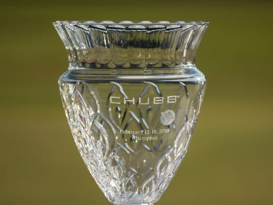 The Chubb Classic trophy sits on a table at the 18th hole during the final day of the Chubb Classic in Naples on Sunday.