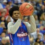 Yahoo: Agent told bosses Adidas paid mother of Kansas basketball star Josh Jackson