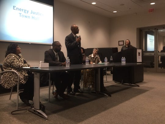 Clint Richardson (center) with Memphis Light, Gas & Water customer relations answers questions in a town hall meeting Thursday about a proposal to automatically round up utility bills and use the difference to fund low-income weatherization grants.