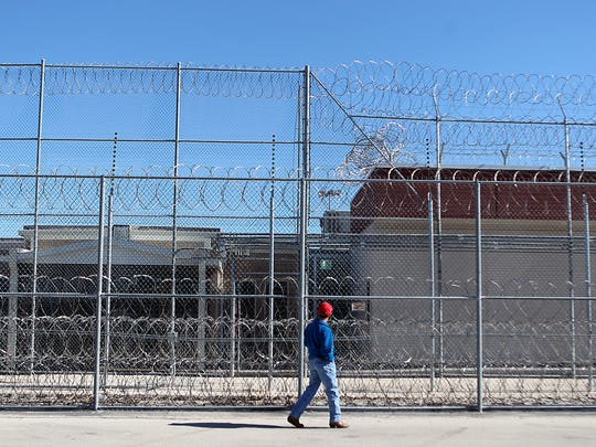William Carter II, director of the Lubbock County Juvenile Justice Center, takes a walk in front of the now closed Eden Detention Center during a tour around the city of Eden on April 30, 2017.