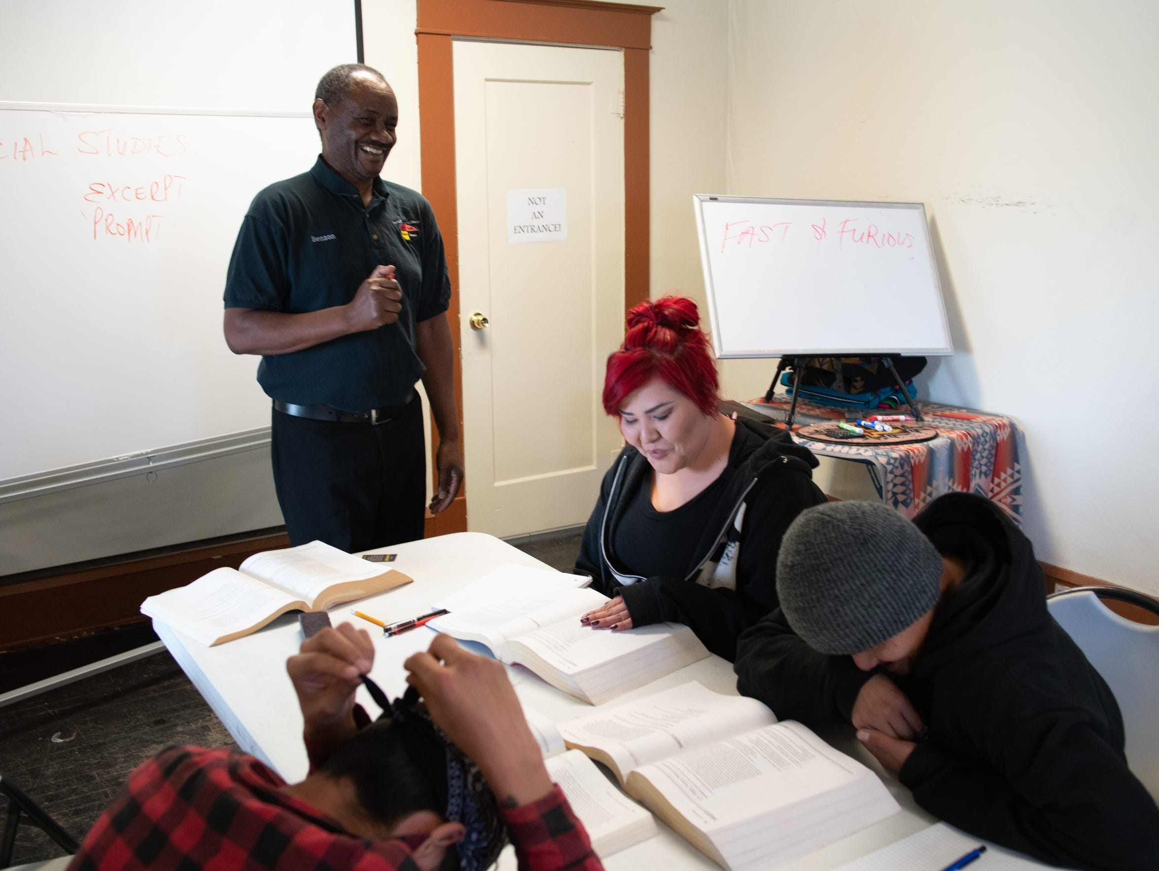 Ndolo teaches the class, as student Talena Shirley,