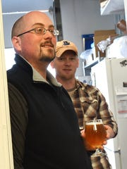 River's Edge Brewing Co. owner Ryan Wiltse watches