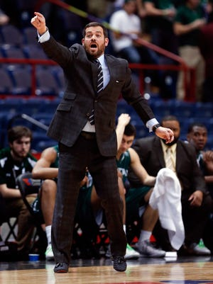 Manhattan head coach Steve Masiello signals to his players during the first half of an NCAA college basketball game in the MAAC conference tournament championship against Iona, Monday, March 9, 2015, in Albany, N.Y. (AP Photo/Mike Groll)