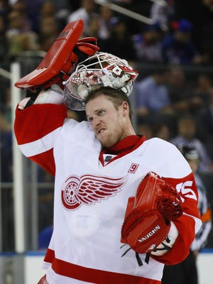 Jimmy Howard of the Detroit Red Wings takes a break during the game against the New York Rangers at Madison Square Garden on Oct. 19, 2016 in New York City.