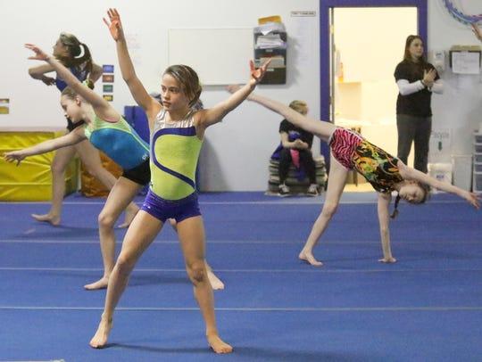 Elmira Gymnastics Club members Grace Freeman, front,