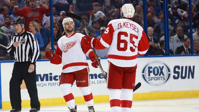Detroit Red Wings defensemen Mike Green, left, and Danny DeKeyser after he scored against the Tampa Bay Lightning in Game 1.