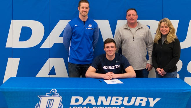 Danbury senior Justin Tibbels continues his football career at Marietta College. He's joined at his announcement by Lakers coach Keith Mora, John Tibbels and Andrea Tibbels.