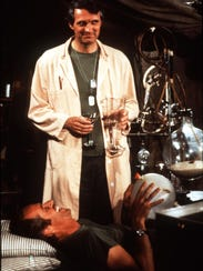 Alan Alda and Mike Farrell in a scene from the TV show M*A*S*H.