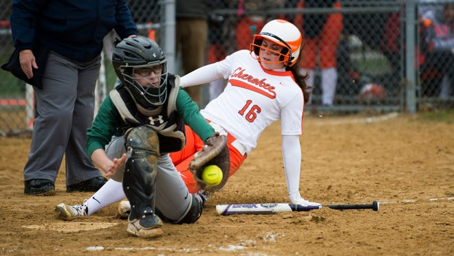 Cherokee's Meg Gray (16) slides safe into home against Camden Catholic's Bri Denner (6) Tuesday, April 3, 2018 at Cherokee High School in Marlton, N.J. Cherokee won 10-0.