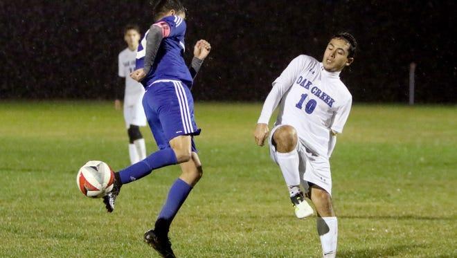Oak Creek's Simar Perez sends the ball past a Racine Park defender at Oak Creek on Oct. 10.