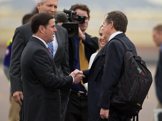 Arizona Gov. Doug Ducey (left) welcomes New England