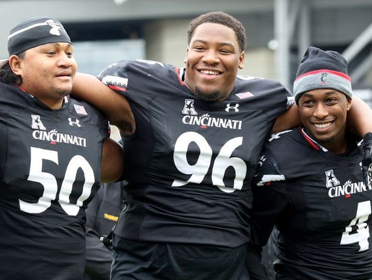 UC defensive players Sione Tongamoa, Cortez Broughton