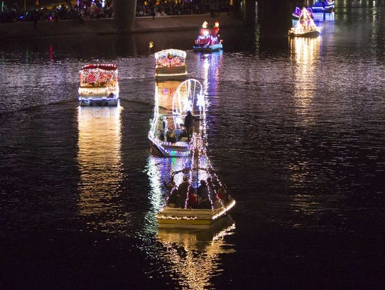 Watch a parade of illuminated boats float by on Tempe