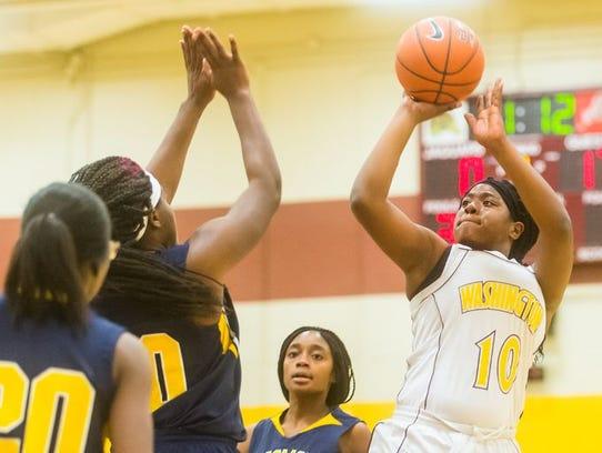 Washington High's Danasia Roberts (10) takes a shot