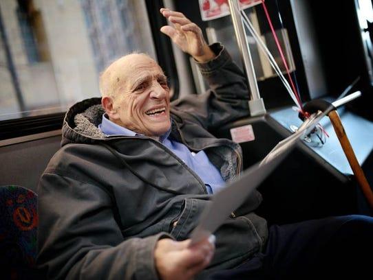 Angelo Fracassa, 86, of Detroit is overcome with joy