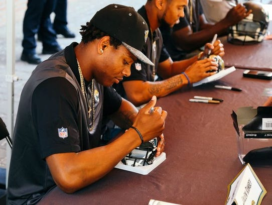 Jalen Ramsey signs an autograph during the Tallahassee