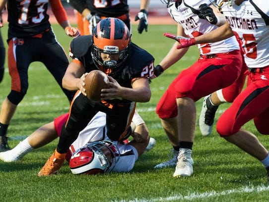 Hanover's Justin Barnes (22) dives for a touchdown