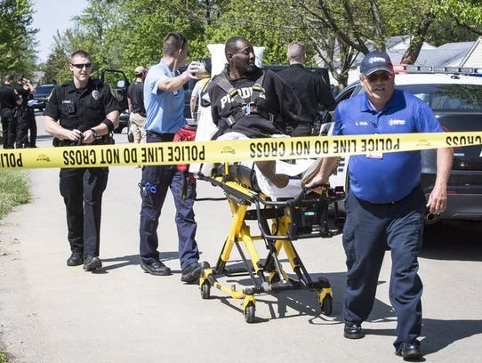 Emergency personnel transport a man reportedly shot