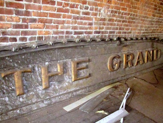 The sign for the former Grand Theater in Elmira was